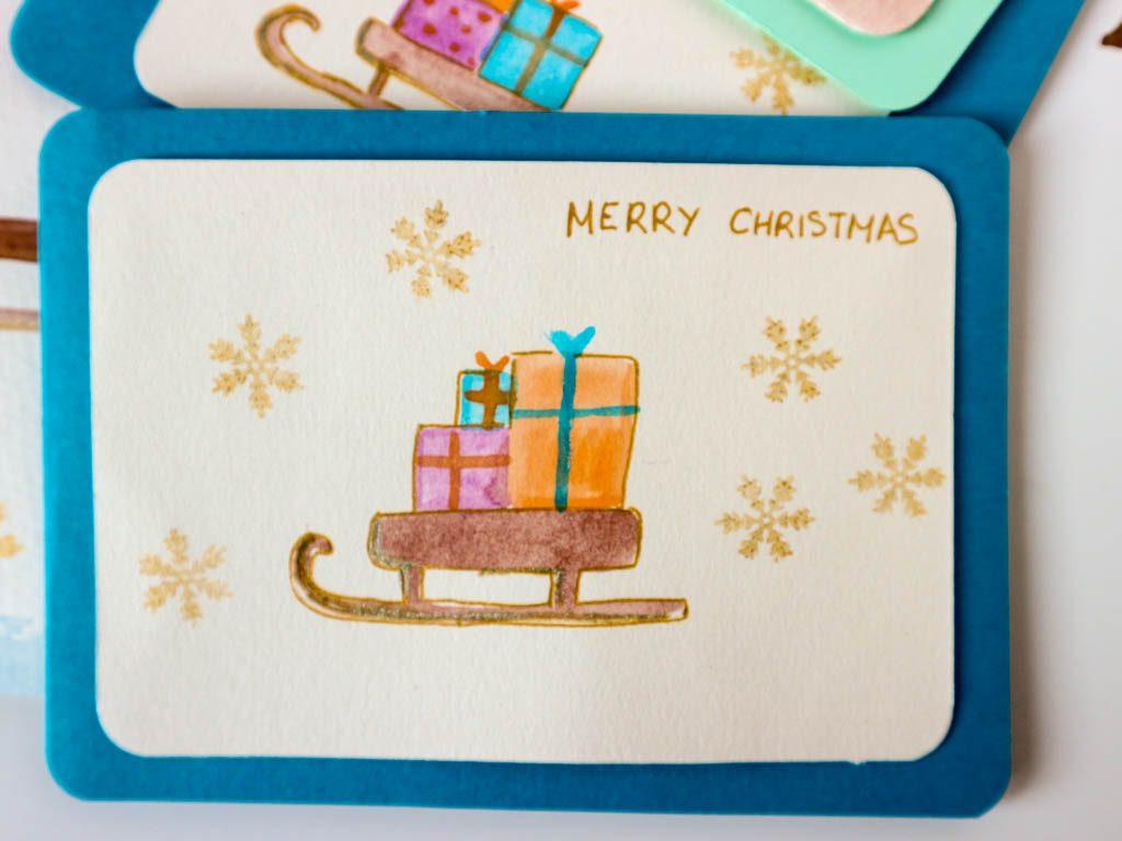 postal de navidad: trineo con regalos