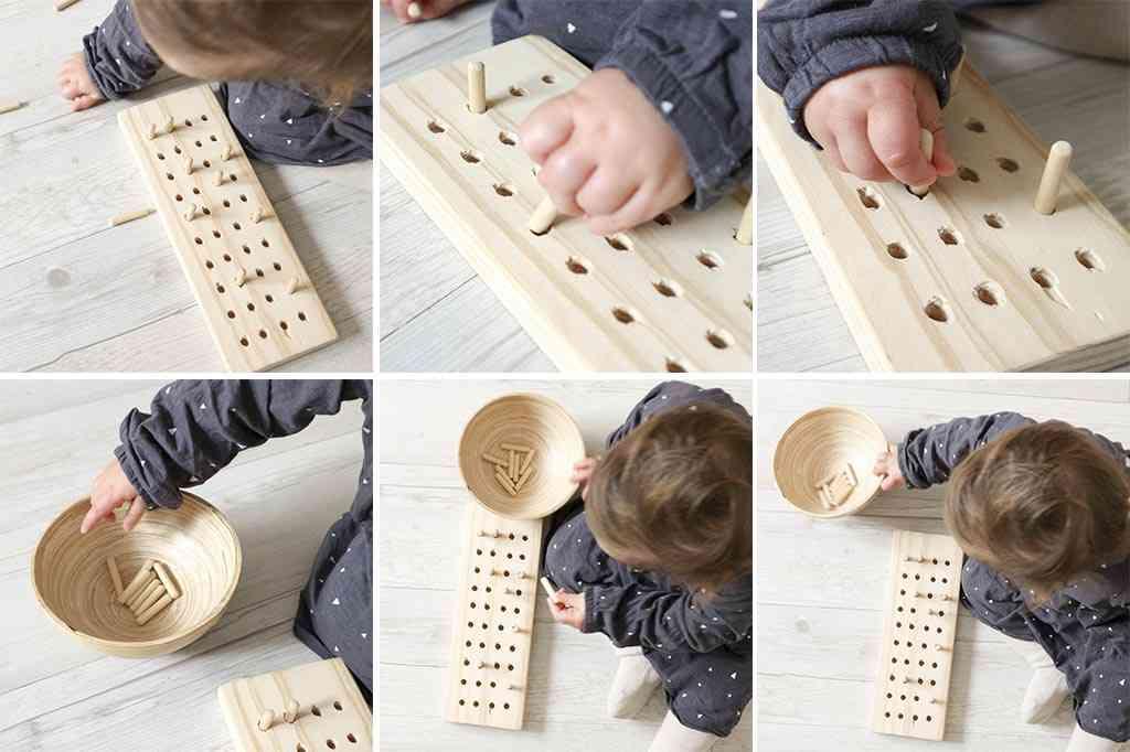 bebe jugando con material montessori casero